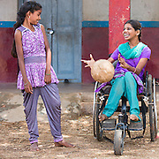 CAPTION: Shilpa, who has cerebral palsy and moves around in a wheelchair, has developed her confidence level dramatically since joining her local After-School Club (ASC). Its sessions are designed to be highly inclusive, so she feels she is able to engage in activities without disadvantage compared with the other children there. LOCATION: Heggotara (village), Kasaba (hobli), Chamrajnagar (district), Karnataka (state), India. INDIVIDUAL(S) PHOTOGRAPHED: Manasa and Shilpa N. (right).