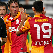 Galatasaray's Johan Elmander (L) with Umut Bulut celebrating his goal during their Turkish Superleague soccer derby match Besiktas between Galatasaray at the Inonu Stadium at Dolmabahce in Istanbul Turkey on Thursday, 26 August 2012. Photo by TURKPIX