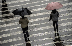 August 15, 2017 - SâO Paulo, São Paulo, Brazil - SAO PAULO SP, SP 15/07/2017 RAINY DAY IN SÃO PAULO People walk through a cold and wet night in Sao Paulo on August 15, 2017 in Brazil. Sao Paulo City has experienced a wet and cold fall. (Credit Image: © Cris Faga via ZUMA Wire)