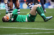 Preston North End Goalkeeper Jordan Pickford lies injured. Skybet football league championship match, Preston North End v Cardiff City at the Deepdale stadium in Preston, Lancashire on Saturday 17th October 2105.<br /> pic by Chris Stading, Andrew Orchard sports photography.