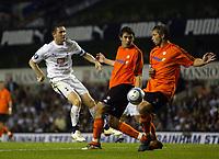 Photo: Chris Ratcliffe.<br /> Tottenham Hotspur v Slavia Prague. UEFA Cup. 28/09/2006.<br /> Robbie Keane of Spurs gets a shot away from the Prague defence.