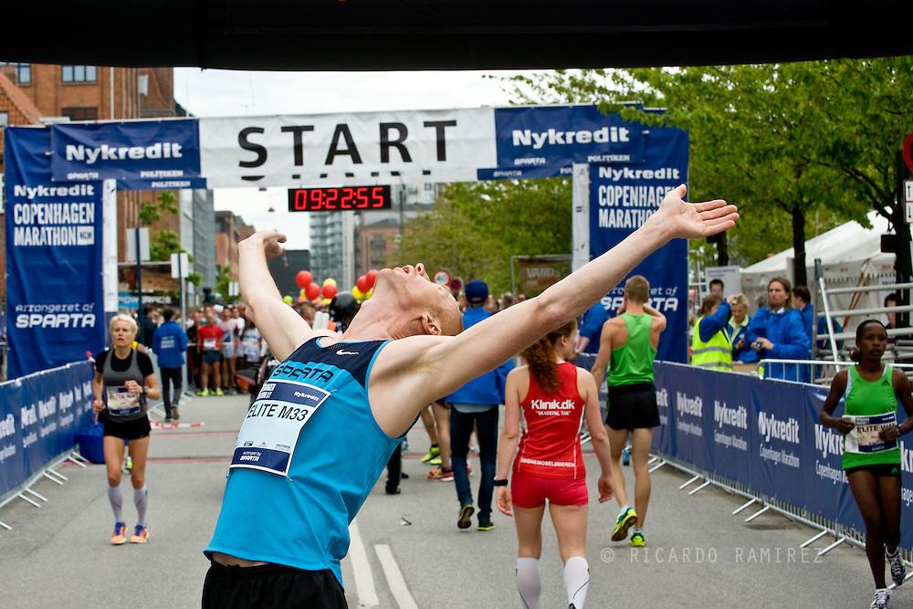 18.05.14. Copenhagen, Denmark.  Kenya's Julius Kiprono Muta was the winner of the Copenhagen Marathon 2014, after running 42,195 km in 2 hrs, 17 minutes and 54 seconds. About 12,010 contestants participated in the marathon that started in Islands Brygge.Photo: © Ricardo Ramirez
