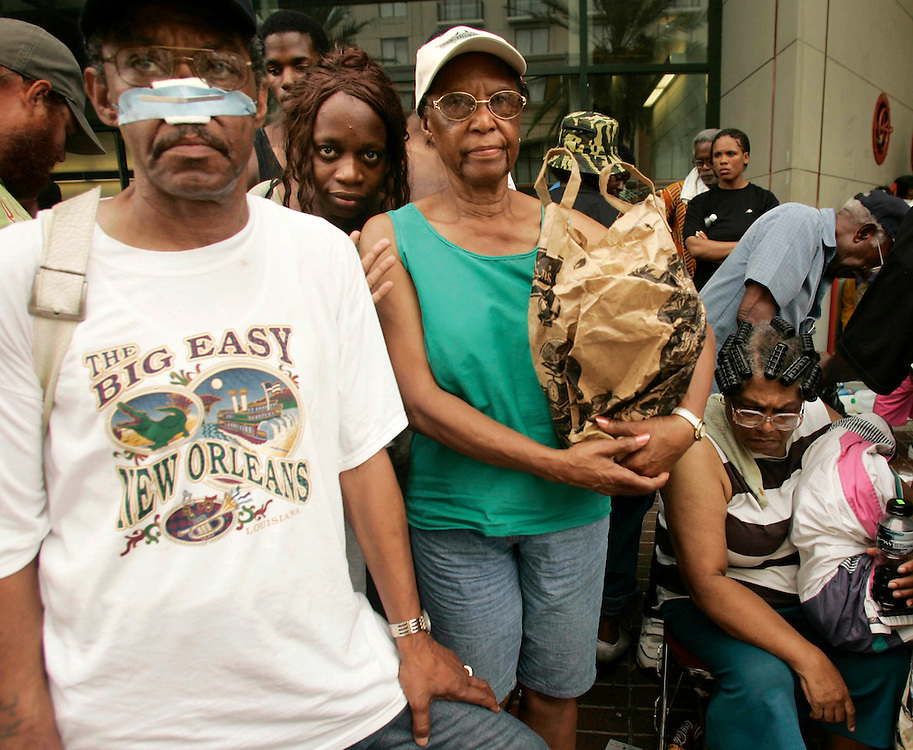 New Orleans evacuees wait in vain for transportation out of the city from its Convention Center September 1, 2005. Several people among the thousands of stranded hurricane evacuees have died while waiting outside the building, with no sign of imminent help on the way. REUTERS/Rick Wilking