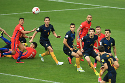 25th June 2017 - FIFA Confederations Cup (Group B) - Chile v Australia - Players watch the ball as it floats towards them in the box - Photo: Simon Stacpoole / Offside.