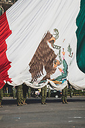 Mexico City, Mexico - October 28, 2014: Members of the Mexican military raise the national flag at 8 o'clock in the morning in Mexico City's main plaza called the Zócalo.