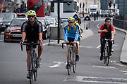 From the direction of Westminster Bridge, cyclists pass through the cycle lane in Parliament Square in Westminster, on 16th September 2020, in London, England.