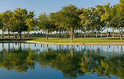 Joggers along the pond at Storey Park in Houston, Texas
