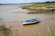 Rowing boat in mud River Deben Shottisham Creek Suffolk England