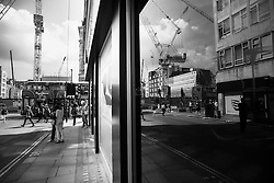 Oxford Street. Cranes have become a symbol of London skyline, a costant presence that is evolving London cityscape.
