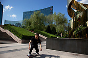 Skateboarder using a sculpture as his skate park. Zhongguancun or Zhong Guan Cun, is a technology hub in Haidian District, Beijing, China. It is situated in the northwestern part of Beijing city. Zhongguancun is very well known in China, and is often referred to as China's Silicon Valley. This is Beijing's computer district with numerous tech companies offices situated here amongst the many malls which sell electronics and electrons equipment of all kinds. The tech park started as a small office where two decades ago some students from a nearby university decided that computer equipment may be a thing of the future so set up a small company. It has expanded in this time to  cover many square kilometres.