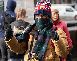 Edinburgh, Scotland, UK. 11 March, 2020. Asian tourists wearing face masks on the Royal Mile in Edinburgh today. Scotland, UK