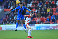 Kgosi Nthle heads clear during the EFL Sky Bet League 1 match between Doncaster Rovers and Rochdale at the Keepmoat Stadium, Doncaster, England on 1 January 2019.