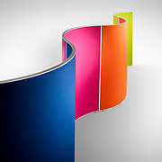 A studio furniture product shoot showing the curves of a brightly coloured set of office screens.