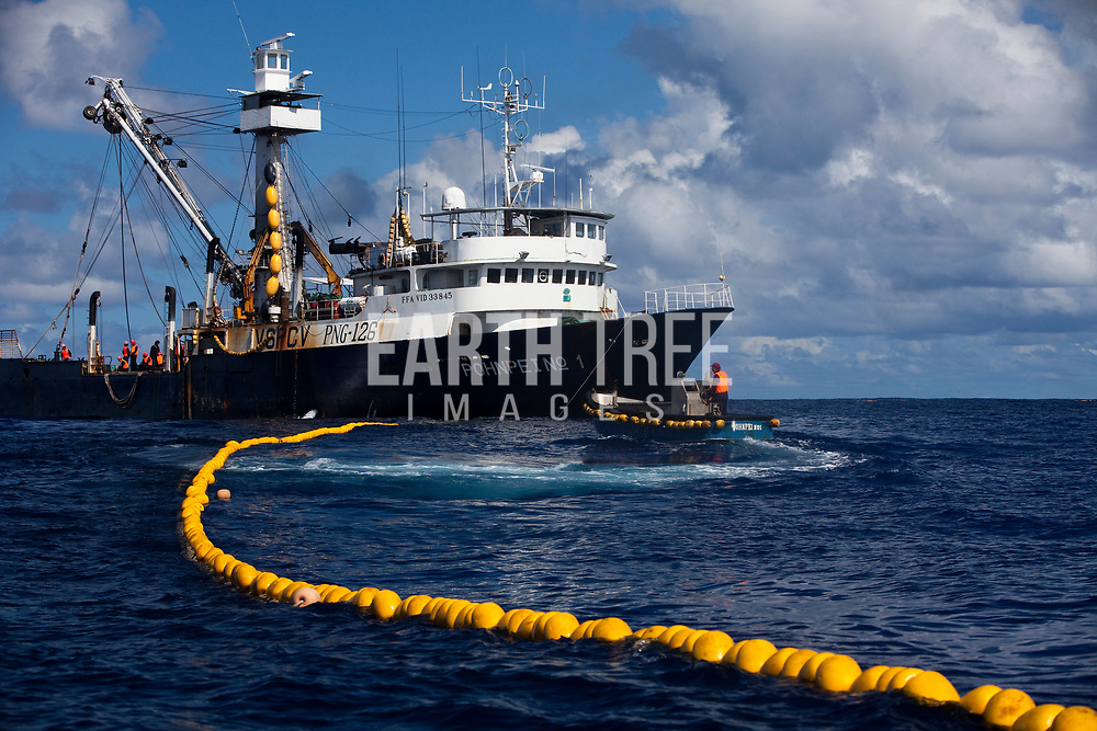 The PNG registered purse seine fishing vessel Pohnpei No 1, puts her nets to work in the Pacific ocean, 10th September 2009. Greenpeace/Paul Hilton