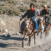 Horseman ride a trail in the Kali Gandaki Valley, Nepal