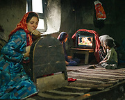 A women breastfeeding her newly born. Jumagul is the head of the tiny village . The traditional life of the Wakhi people, in the Wakhan corridor, amongst the Pamir mountains.