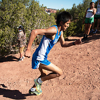 """Navajo Pine High School senior Galvin Curley makes his way up """"Heartbreak Hill"""" during the varsity boys 5000 meter course Saturday morning at the Heartbreak Classic cross country meet in Navajo. Curley took first place with a time of 18:23."""
