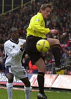 Photo. © Peter Spurrier/Sportsbeat Images<br /> 28/02/2004  -  Nationwide Div 1 Watford v Wimbledon<br /> Watfords Neal Ardley, redirect the ball as Wimbledon's Peter hawkins challenges.