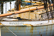 Old weathered sailboat in the Ventura Marina, Ventura, California USA
