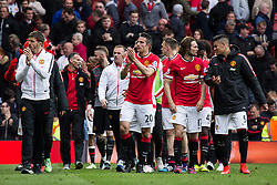 © Licensed to London News Pictures . 17/05/2015 .  Old Trafford , Manchester , UK . Manchester United players walk a lap of honour around the pitch after the match . Manchester Utd vs Arsenal at Old Trafford Football Stadium , Manchester . Photo credit : Joel Goodman/LNP