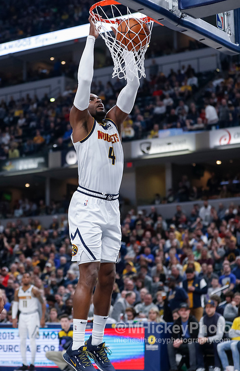 INDIANAPOLIS, IN - MARCH 24: Paul Millsap #4 of the Denver Nuggets dunks the ball at Bankers Life Fieldhouse on March 24, 2019 in Indianapolis, Indiana. NOTE TO USER: User expressly acknowledges and agrees that, by downloading and or using this photograph, User is consenting to the terms and conditions of the Getty Images License Agreement.(Photo by Michael Hickey/Getty Images) *** Local Caption *** Paul Millsap