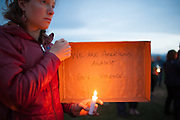 Natalie Dawson of Missoula, attends the vigil for slain German exchange student, Diren Dede, on May 2, 2014, at the Fort Missoula soccer field where Dede had played.
