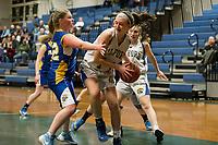 Franklin's Meghan Johnston keeps pressure on Gilford's Lauren Dean during NHIAA Division III basketball Tuesday evening.  (Karen Bobotas/for the Laconia Daily Sun)