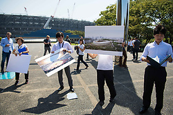 September 5, 2018 - Tokyo, JAPAN - 180905 Staff showcase how the Olympic Stadium, arena to be used for athletics, football and the Opening Ceremony and Closing Ceremony, will look like after construction, during the first World Press Briefing for the 2020 Olympic Games on September 5, 2018 in Tokyo..Photo: Joel Marklund / BILDBYRÃ…N / kod JM / 87776 (Credit Image: © Joel Marklund/Bildbyran via ZUMA Press)