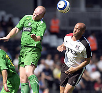 Fotball<br /> England 2005/2006<br /> Foto: SBI/Digitalsport<br /> NORWAY ONLY<br /> <br /> 16/07/05.<br /> Fulham v Celtic<br /> Pre season friendly<br /> <br /> Fulham's Claus Jensen is beaten to this header by Celtic's John Hartson