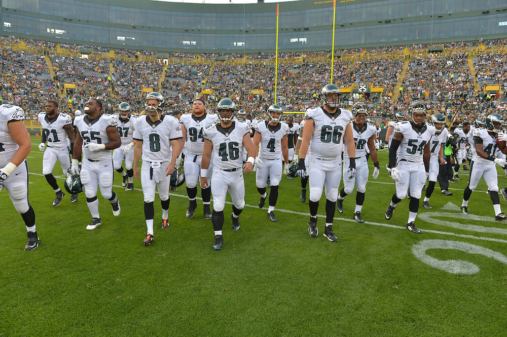 Full team group, huddle against the Green Bay Packers at Lambeau Field on August 29, 2015 in Green Bay, Pennsylvania. The Eagles won 39-26. (Photo by Drew Hallowell/Philadelphia Eagles)