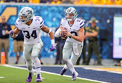 Sep 22, 2018; Morgantown, WV, USA; Kansas State Wildcats quarterback Skylar Thompson (10) runs out of the pocket during the first quarter against the West Virginia Mountaineers at Mountaineer Field at Milan Puskar Stadium. Mandatory Credit: Ben Queen-USA TODAY Sports
