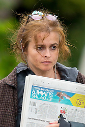 EXCLUSIVE: Helena Bonham Carter looks like she just rolled out of bed as she goes make-up free and wears slippers to buy her morning newspaper. The hollywood actress wore a pink baggy skirt, hoodie and long baggy jacket as she ran errands and met up with friends for a coffee. 29 Jun 2017 Pictured: Helena Bonham Carter. Photo credit: MEGA TheMegaAgency.com +1 888 505 6342