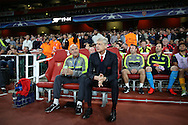 Arsene Wenger, the Arsenal manager looks on from his dugout seat before k/o. UEFA Champions league group A match, Arsenal v FC Basel at the Emirates Stadium in London on Wednesday 28th September 2016.<br /> pic by John Patrick Fletcher, Andrew Orchard sports photography.