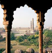 View through minaret arch towards the Great Imambara, Lucknow, Uttar Pradesh, India