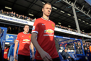 Jonny Evans of Manchester United enters the pitch before k/o. Barclays Premier league match, Queens Park Rangers v Manchester Utd at Loftus Road in London on Saturday 17th Jan 2015. pic by John Patrick Fletcher, Andrew Orchard sports photography.