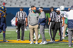 Oct 3, 2020; Morgantown, West Virginia, USA; Baylor Bears head coach Dave Aranda talks with West Virginia Mountaineers head coach Neal Brown prior to their game at Mountaineer Field at Milan Puskar Stadium. Mandatory Credit: Ben Queen-USA TODAY Sports
