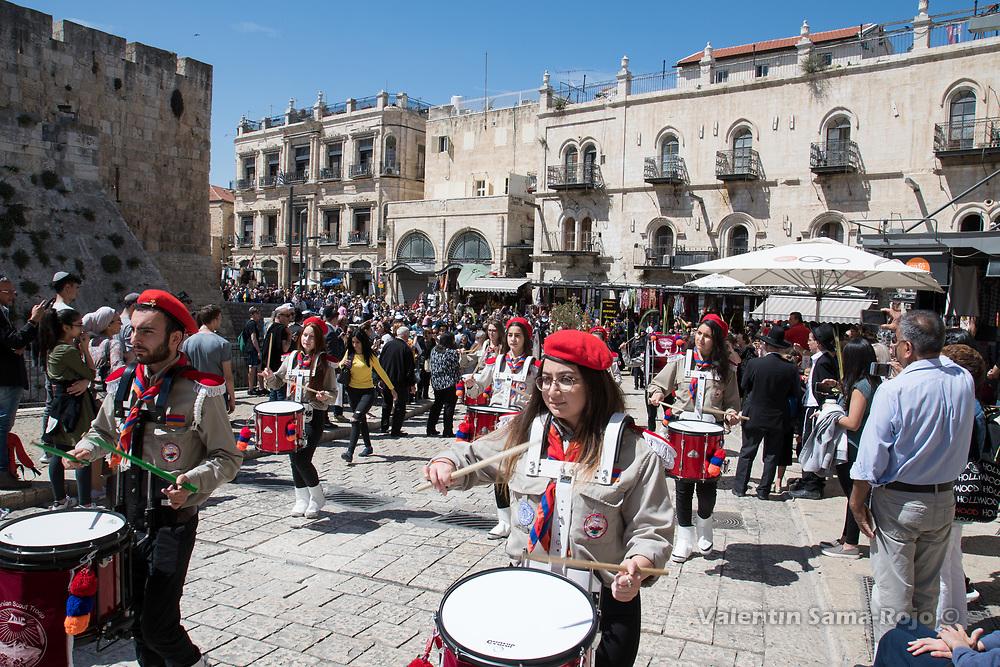 Jerusalem, Israel. 1st April, 2018. Members of the Armenian Scout Troops of Jerusalem opening the Armenian Palm Sunday procession playing drums. © Valentin Sama-Rojo.