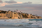 Waves crash onto shore at sunset in Laguna Beach, California.