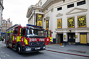 The Lyceum Theatre which is home to The Lion King as London Fire Brigade pump out water which flooded the orchestra pit in the basement of the theatre while it was closed due to coronavirus on 12th May 2020 in London, England, United Kingdom. Coronavirus or Covid-19 is a new respiratory illness that has not previously been seen in humans. While much or Europe has been placed into lockdown, the UK government has now announced a slight relaxation of the stringent rules as part of their long term strategy, and in particular social distancing.