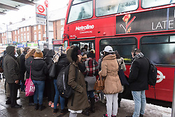 © Licensed to London News Pictures. 10/12/2017. London, UK. People queue to get on a  bus in Wembley, North London, as heavy snow fell early morning. The weather has caused travel disruption in the capital. Photo credit: Ray Tang/LNP