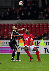 Nottingham Forest's Dele Adebola  Battles for the ball with Bristol City's Steven Caulker - Photo mandatory by-line: Matt Bunn/JMP - 25/01/2011 - SPORT - FOOTBALL - npower championship-Nottingham Forest v Bristol city-City Ground-Nottingham