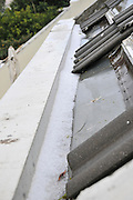 hail collects in a gutter after a hail storm, Photographed in Haifa, Israel in January