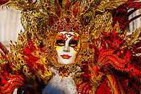 Woman in carnival costume, Bridge of Sighs, Venice Carnival (Carnevale di Venezia), Venice, Italy.