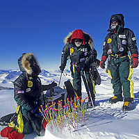 """ANTARCTICA, Mount Vaughan Expedition. Carolyn Muegge-Vaughan lights 89 birthday """"candles"""" for Norman Vaughan atop 10,302' summit named for him by Richard Byrd."""