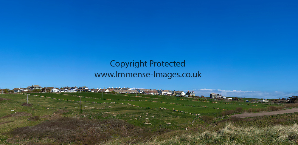 greenfields with drystone walls and blue sky