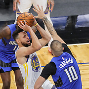 ORLANDO, FL - FEBRUARY 19:  Stephen Curry #30 of the Golden State Warriors attempts a shot over Evan Fournier #10 of the Orlando Magic during the first half at Amway Center on February 19, 2021 in Orlando, Florida. NOTE TO USER: User expressly acknowledges and agrees that, by downloading and or using this photograph, User is consenting to the terms and conditions of the Getty Images License Agreement. (Photo by Alex Menendez/Getty Images)*** Local Caption *** Stephen Curry; Evan Fournier