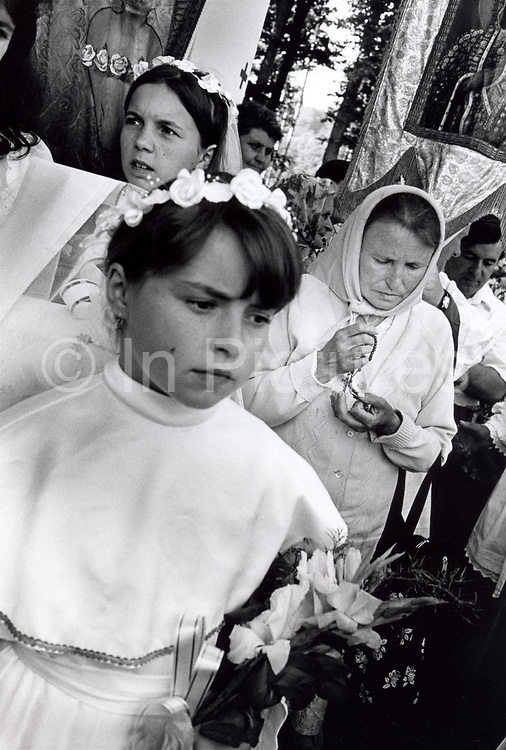 A group of young young girls dressed in white at the festival of the Assumption in Kalwaria Paclawska, Poland. The Assumption of the Virgin Mary into Heaven, informally known as The Assumption, according to the beliefs of the Roman Catholic Church, Eastern Orthodoxy, Oriental Orthodoxy, and parts of Anglicanism, was the bodily taking up of the Virgin Mary into Heaven at the end of her earthly life.