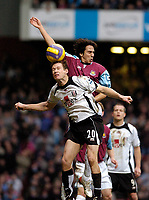 Photo: Leigh Quinnell.<br /> West Ham United v Fulham. The Barclays Premiership. 13/01/2007. West Hams Yossi Benayoun rises with Fulhams Brian McBride.