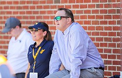 Sep 4, 2021; College Park, Maryland, USA; West Virginia athletic director Shane Lyons watches during warmups prior to their game against the Maryland Terrapins at Capital One Field at Maryland Stadium. Mandatory Credit: Ben Queen-USA TODAY Sports
