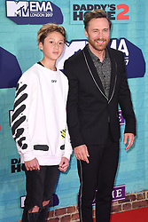 David Guetta and son Elvis arriving at the MTV Europe Music Awards 2017 held at The SSE Arena, London. Photo credit should read: Doug Peters/EMPICS Entertainment